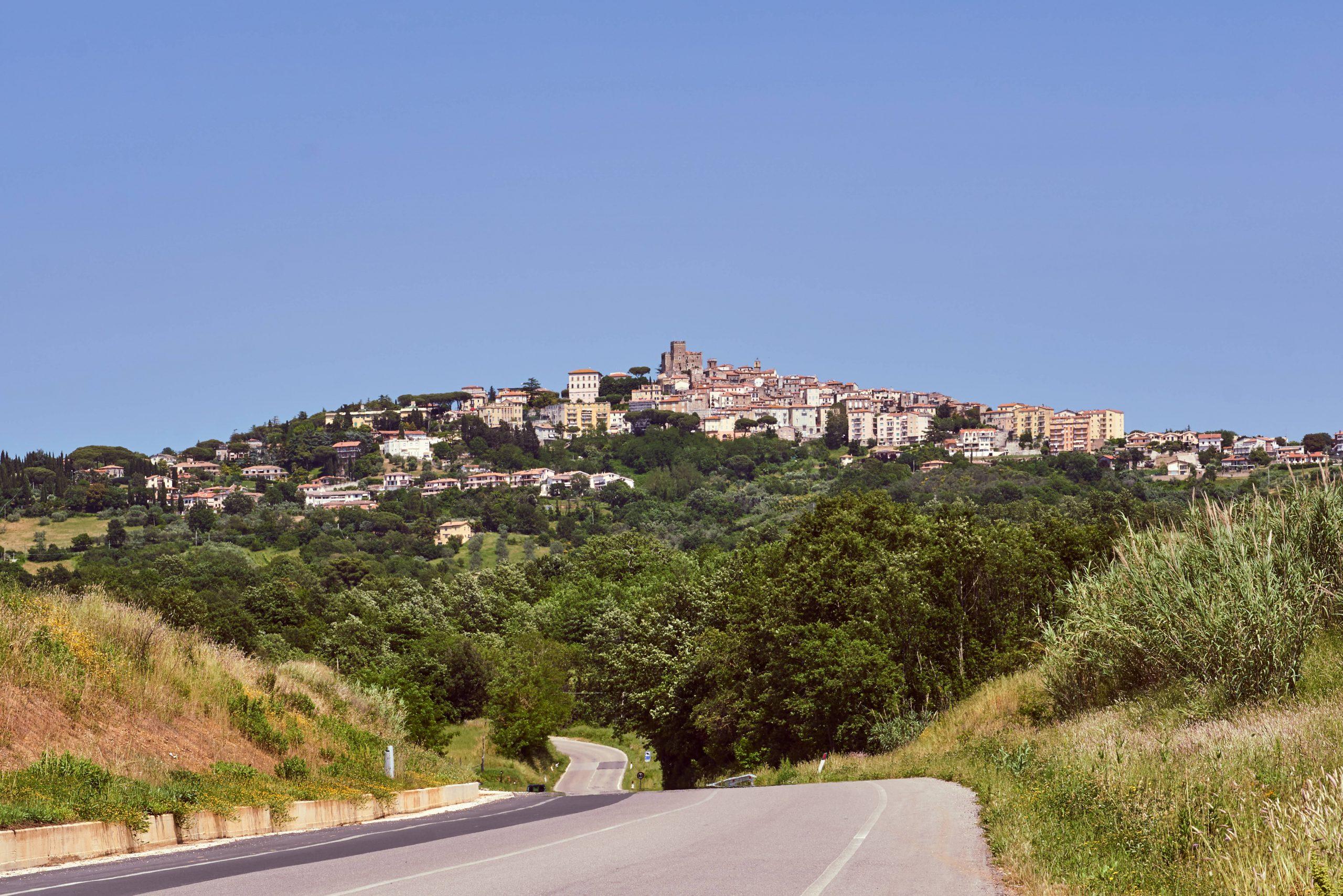 Canva - Asphalt road to the city of Manciano in Tuscany